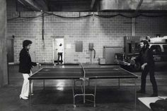 Bob Dylan and Levon Helm playing ping-pong.