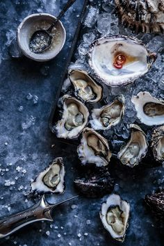 A post all about Oysters 6 Ways | Oyster Marinades | Soy, Sesame, Ginger & Chilli | Lemon | Champagne Vinegarette | Kilpatrick | Summer | Seafood | Party | Oyster Knife | Dark Food Photography | Moody | Chiaroscuro | Food Photography | Food Styling | Food Props | Anisa Sabet | The Macadames