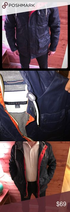 Tommy Hilfiger waxed Navy field jacket MSRP $248 Tommy Hilfiger waxed Navy field jacket size Medium MSRP $248. Excellent condition! This jacket has so many great pockets and just pops with the navy and orange. It's hooded too. Tommy Hilfiger Jackets & Coats Military & Field
