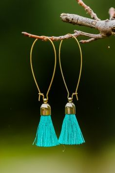 Go For It Aqua Tassel Earrings at reddressboutique.com