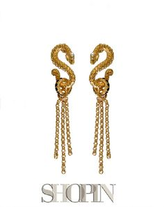 This Shopin earrings feature a Snake pendant with a scaly surface and a round hook with with attached pieces of chain  Gold plated bronze, black and white zircons. Nickel free and hypo-allergenic. Made in Italy.