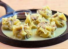 siomai is a steamed dumpling filled with delicious mix of ground chicken, shrimp, napa cabbage, shitake mushrooms and green onions