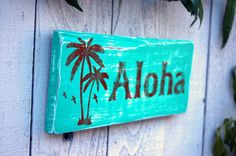 """""""Aloha"""" is a fun rustic wood hand painted beach cottage home decor sign that that is great for indoor and outdoor use,The sign is perfect for that warm welcoming beach house theme. You'll love this sign! by Jetmak Design $37.00"""
