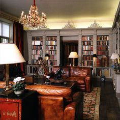 Built in bookshelves with leather couches