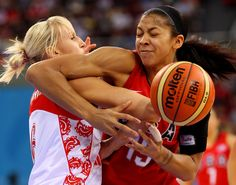 Natalia Vodopyanova of Russia fights for a loose ball with Candace Parker of the United States during their Women's Semifinals basketball game at the Wukesong Indoor Stadium during Day 13 of the Beijing 2008 Olympic Games on August 21, 2008 in Beijing, China.