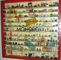 Collection of Monopoly pieces from the to the near present. The collectors created a display case by framing a vintage Monopoly board and adding glass shelves. Monopoly Pieces, Monopoly Board, Monopoly Party, Toy Display, Display Ideas, Display Cases, Vintage Board Games, Displaying Collections, Game Pieces