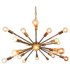 Vintage American Midcentury Brass Sputnik Chandelier   From a unique collection of antique and modern chandeliers and pendants at https://www.1stdibs.com/furniture/lighting/chandeliers-pendant-lights/