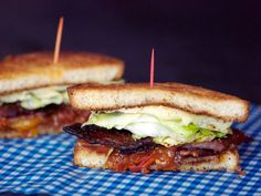 BLTs are one of my top restaurant orders: toasted bread, ripe tomatoes, refreshing iceberg lettuce, a slather of mayo, and a layer of crisp, greasy bacon. It can't be messed up, but of course, it can get a few alterations. Like candied bacon and tomato jam.