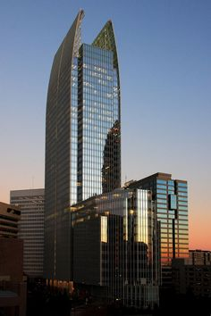 1180 Peachtree Street, also known as Symphony Tower, Atlanta, Georgia; This office tower with ground floor retail has more than one acre of the site devoted to public spaces, plazas, gardens, and seating areas adjacent to the city's largest public park.
