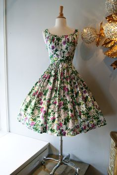 50s Dress // 50s Party Dress // Vintage 1950s Fabulous Floral Cotton Fit and Flare Dress with Little Bow Detail Size XS. $198.00, via Etsy.