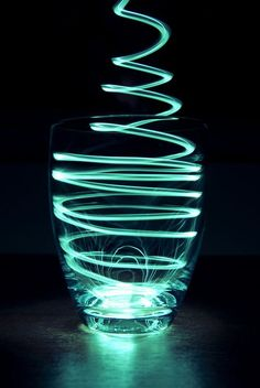 This is a very great example of light painting photography. It is a good lighting inspiration and it uses a light source to create the affect of painting. The main subject which is the glass, it mainly focused around the light source.