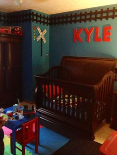 "Kyle's ""Thomas The Train"" themed room. I used picket fence (cut the tops off) for the railroad track."