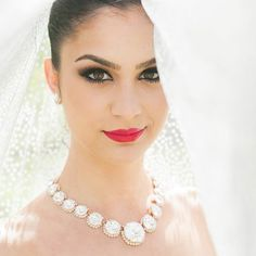 dramatic eye and bold red lip - a gorgeous wedding makeup look! ~  we ❤ this! moncheribridals.com