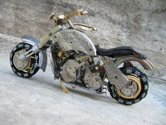 Toronto-based sculptor Dan Tanenbaum makes miniature motorcycles crafted entirely from vintage watch parts. You can check out more builds at his Watch Parts Motorcycles Facebook page.