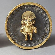 STAR GATES:  A MAN WITH A SPESIAL SUE?? HELMET?? EARPHONE?? WHAT IS THE MESSAGE FOR US?? WHAT DO YOU SEE??? Earflare,Date: 2nd–3rd century Geography: Peru Culture: Moche (Loma Negra) Medium: Gold, silver, stone