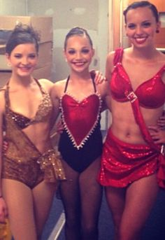 Brooke, Maddie, and Payton in solo costumes