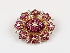 Ring / Brooch Ruby & Diamond 14k Gold 5.27 ctw Vintage Ruby & Diamond brooch dating to the 1940's or 50's crafted in 14k gold with custom ring for versatility in wearing. You could use the ring with other brooches creating entirely new rings! I have tried it with several brooches I have in stock and it works beautifully. For thousands of years, the ruby has been considered one of the most valuable gemstones on Earth. It has everything a precious stone should have: magnificent colour…
