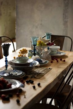 eclectic dinnerware on a farm table
