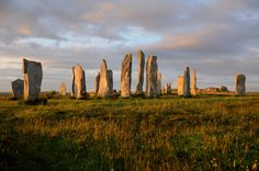 Callanish standing stones at dawn, Isle of Lewis, Scotland they look like they have mystical properties, don't they? Outlander, Outer Hebrides, Countries Of The World, Monument Valley, New York Skyline, Scotland, Places To Visit, Landscape, Explore