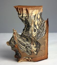 Artist Creates Massive Altered Book Sculptures Coated in Wax by Jessica Drenk - Reading Our Remains Carving | Click for full post! #bookart