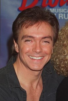 David Cassidy smiles during rehearsal for photos at a New York studio Aug. 4, 1993. He is taking over a role in the Broadway musical 'Blood Brothers' Aug.16 when his brother Shawn Cassidy also will join the cast in the role of his on-stage 'blood brother.' (AP Photo/Richard Drew)