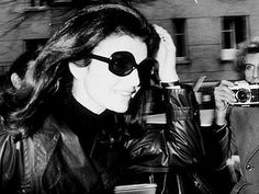 Jackie O: loose hair, Cartier tank, Persol sunglasses, slim leather jacket and a black turtle neck.