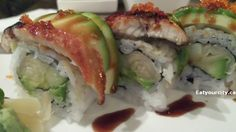 Genki roll is Unagi and ginger flavoured combined with avocado, cucumber and tobiko. Didn't taste any ginger, but if you got a piece that had the grilled unagi (eel) it was moist and tasty Sushi Rolls, Food Items, Cucumber, Restaurants, Avocado, Abs, Tasty, Ethnic Recipes, Crunches