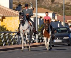 A proud father and daughter arrive at the Albox fiesta upon their horses, ready for the equine competition. Almeria, Spain