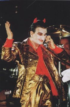 For the European leg of U2's ZooTV tour during the early '90s, Bono introduced his over-the-top rock-star take on the devil, MacPhisto. Bono imagined the devil as an aging glam rocker who had long ago sold his soul, complete with gold suit, white pancake makeup and horns. MacPhisto performed as part of each set, waxing poetic about politics and morality