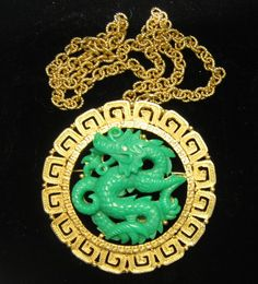 Gold Tone and carved faux jade dragon pendant/necklace. $ 300. I wasn't actually looking for this, but funny how I ran across the same brooch/pendant.