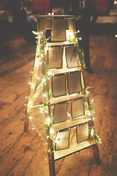 Ladder wedding table plan with tealights and ivy