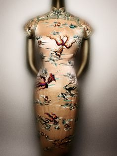 Cheongsam. Chinese, late 1930s. Pink silk satin embroidered with polychrome silk thread and gold metallic piping. Courtesy of Patricia Koo Tsien   Photography © Platon #ChinaLookingGlass #AsianArt100