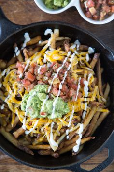 Fiesta Fries loaded with cheese, guacamole, pico de gallo and a touch of crema!