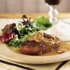 This quick but posh dinner for two of filet mignon with mushroom-wine sauce goes nicely with packaged refrigerated mashed potatoes and bagged salad greens with bottled dressing.