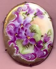 Antique hand painted porcelain pin violets with gilding