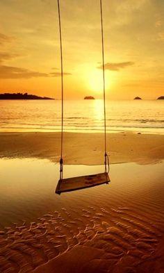Swinging on the seashore