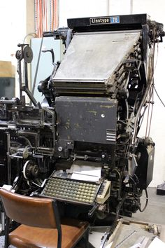"""Linotype machine c.1960 - the end of an era. Invented in the late 19th c., it produces each line of type as a solid piece, as fast as typing on a keyboard is today. The machine assembles matrices, or molds for the letter forms, in a line. The assembled line is then cast as a single piece in a process known as """"hot metal"""" typesetting. The matrices are then returned to the type magazine, to be reused later. Faster than hand composition this was revolutionary. Next came offset litho and…"""