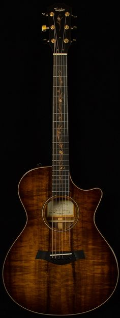 Taylor Wildwood CV K22CE Koa warm wood with gold etched vines down the dark fretboard of this lovely electric guitar - truly an INSTRUMENT FOR JOY.