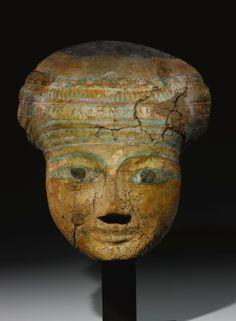 AN EGYPTIAN POLYCHROME WOOD MUMMY MASK, 21ST DYNASTY, 1075-944 B.C.