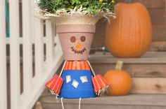 Turn Terra Cotta Pots Into A Charming Scarecrow