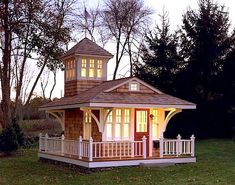 Tiny Cottage with Tower and Surrounding Deck - love the idea of the tower for a radio room and could mount a vertical antenna right off the top! #Tinycottages