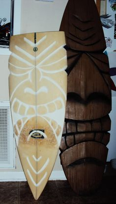 Carved Tiki and twin carved old surfboard. http://www.facebook.com/tikityler