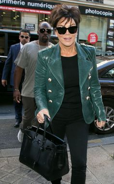 We're beyond obsessed with Kris Jenner's emerald green leather jacket, not to mention her chic black square sunnies!