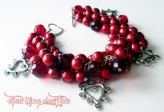 Chunky Pearl Bracelet- Blood Red glass pearls with metal heart charms beaded chunky cluster bracelet - BLOODY VALENTINE - Under 15. $15.00, via Etsy.