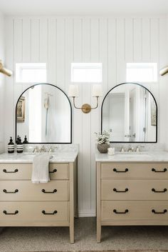 Bathroom Reveal: Bright and airy bathroom with arch doorway shower with brass hardware by The Identite Collective