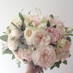 blush and cream bridal bouquet created with the most luscious garden roses, peonies, ranunculus, astilbe, Veronica and seeded eucalyptus.    Less pink, more white flowers