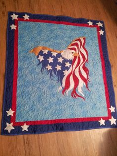 Eagle Wall Quilt.  Great looking patriotic quilt, flag as eagle wings is a great affect.  Peace, Robert from nancysfabrics.com
