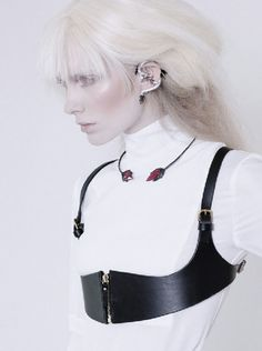 The dark and shiny Anaikka choker in metal with embroidered detailing is perfectly combined with powerful Lucia Odescalchi pieces and a Halaby bracelet. The red ruby and black diamond Red Fang necklace by Theodoros matches the Elise Dray Dragon ear cuff and the leather body ornament by Fleet Ilya.Follow us down the path of inspiration…