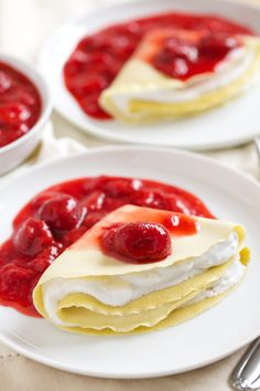 ... with coconut whipped cream and topped with fresh strawberry sauce