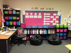 If you are looking for ideas for your classroom this site is one of the best sites I've seen. Great color coordination, colorful bins and black/dark shelves. Black bean bags.